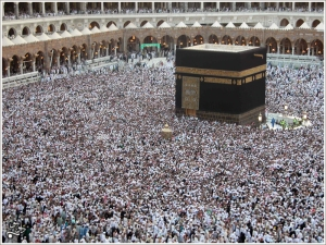 Pilgrims circle the Kaaba in the Holy Mosque at Makkah, Saudi Arabia during the Hajj. Taken by Mo7amaD of flickr in 2006.