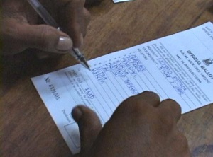 Cotabato army absentee voting - soldier writing on ballot Joseph Estrada. Shot by ABS-CBN Cotabato's Nasser and Lerio Bompat