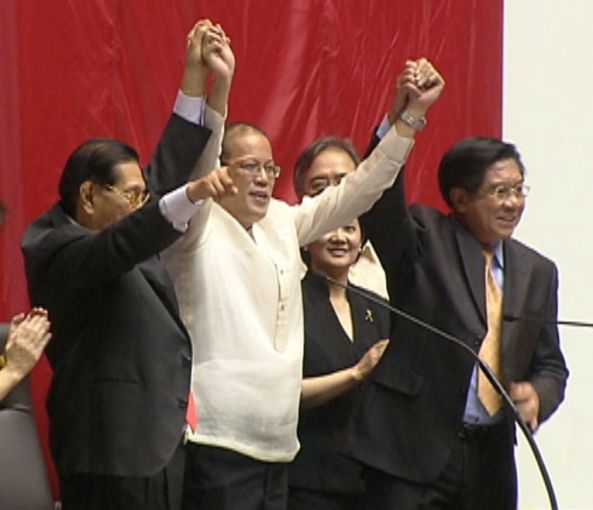 Noynoy Aquino's hands raised by Juan Ponce Enrile and Prospero Nograles on June 9, 2010