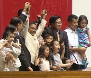 Vice President-elect Jejomar Binay's hands being raised.
