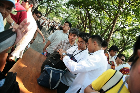 Bag inspections at the UP 2011 graduation. Shot by Ronin Bautista