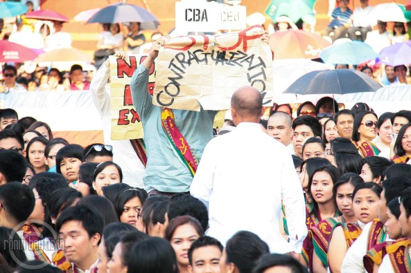 UP graduates raise slogans during Aquino speech. Shot by Ronin Bautista