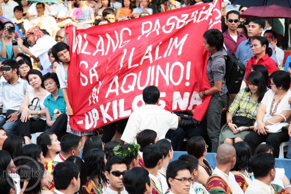 UP students raise slogans during Aquino speech. Shot by Ronin Bautista