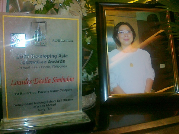 Chit Estella picture and award for story on nursing schools (Shot by Anjo Bagaoisan)