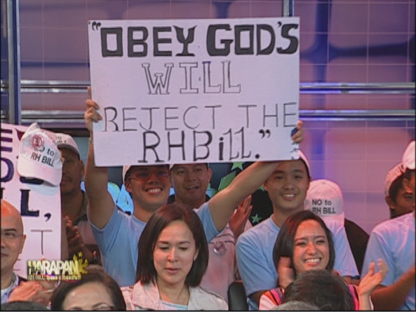 Anti RH Bill audience member at Harapan RH bill Ipasa o Ibasura (Screen grab from ABS-CBN)