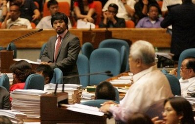 Rep Pacquiao and Rep Lagman debating on the RH bill in Congress (AFP Photo)