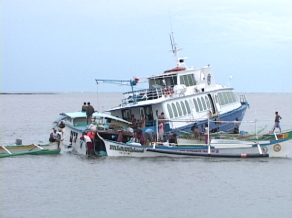 (Shot by Jeff Agustin) Ferry boat crashed with banca in Sta. Ana after typhoon Mina