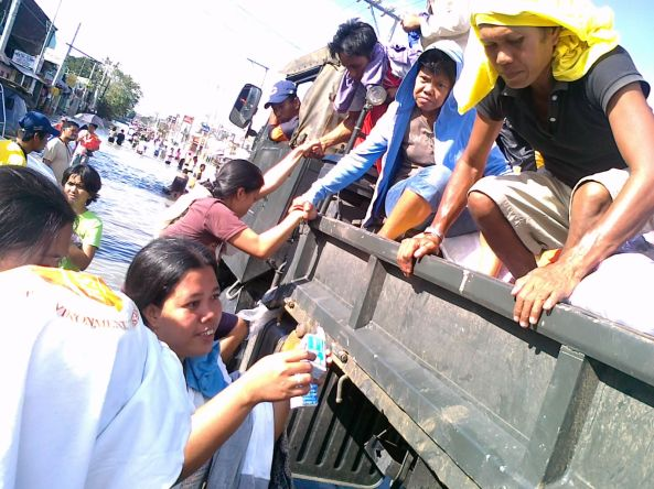 Riding trucks over flooded Calumpit Bulacan October 2011. Shot by Anjo Bagaoisan