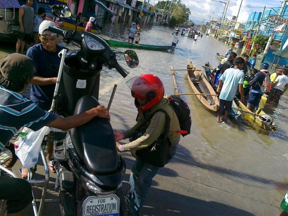 Motorcycles ferried across Calumpit, Bulacan floods October 2011 Shot by Anjo Bagaoisan