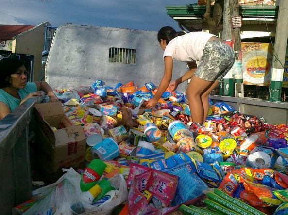 Vendors sorting through soaked goods in flooded Calumpit Bulacan October 2011. Shot by Anjo Bagaoisan