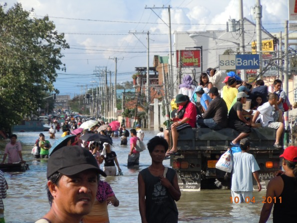 Mass of people walking flooded Calumpit Bulacan town center October 2011. Shot by Chito Concepcion.