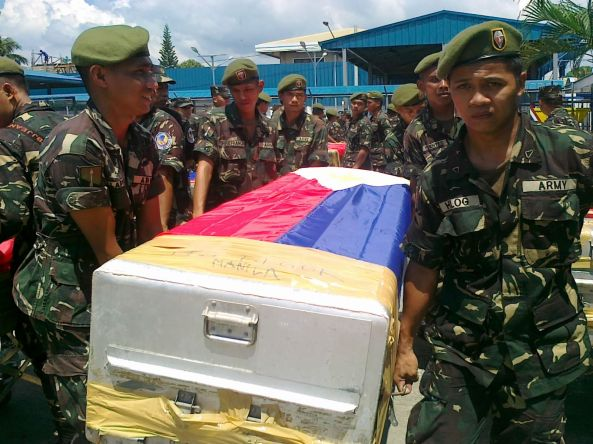 Soldiers carrying coffin of dead soldier in Zamboanga City. (Shot by Anjo Bagaoisan)