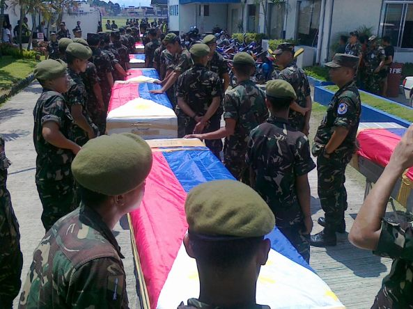 Zamboanga City - Row of coffins containing soldiers killed in Basilan. (Shot by Anjo Bagaoisan)