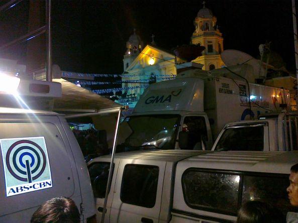 ABS-CBN and GMA 7 vans at Quiapo church 9 Jan 2012 Shot by Anjo Bagaoisan