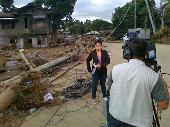 Roxanne Arevalo reporting from Iligan (Shot by Anjo Bagaoisan)