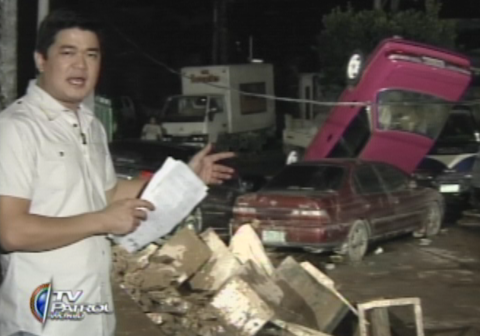 TV Patrol anchor Julius Babao showing the damage of Typhoon Ondoy in Marikina in 2009 (TV Patrol / ABS-CBN News footage))