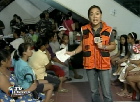 TV Patrol anchor Karen Davila at the disaster response command in Ortigas after Typhoon Ondoy in 2009. (TV Patrol / ABS-CBN News footage)