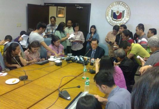 Senate President Juan Ponce Enrile with the Senate media (Shot by Anjo Bagaoisan)
