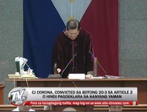 Juan Ponce Enrile, Senate President and impeachment court presiding officer banging the gavel on the guilty verdict against Renato Corona.(ABS-CBN / TV Patrol footage)