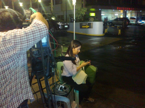 Jenny Reyes on standby for Bandila live report outside Makati Medical Center on July 10, 2012, the night Dolphy died. (Shot by Anjo Bagaoisan)