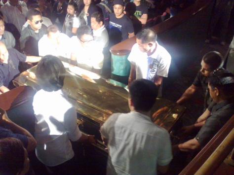 Dolphy's bronze casket being carried at the ABS-CBN Dolphy Theater, July 21, 2012. (Shot by Anjo Bagaoisan)