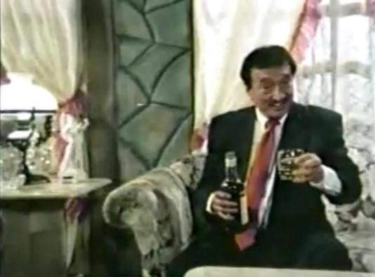 "Dolphy, in a scene from his movie ""Father and Son"", endorses a drink named ""Banayad Whisky"""