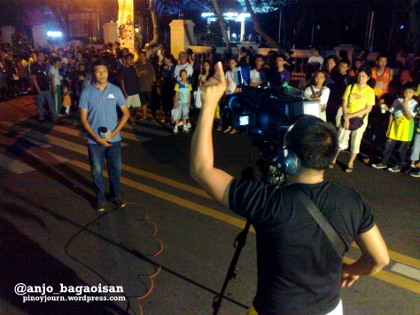 ABS-CBN's Jonathan Magistrado reports for TV Patrol outside Archbishop Palace in Naga, where Jesse Robredo's remains will be brought (Shot August 21, 2012 by Anjo Bagaoisan)