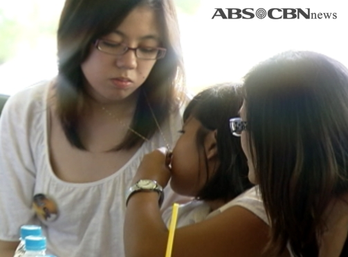 Robredo sisters Jillian and Tricia wear their father Jesse's watch and pendant. (Shot by Rene Casibang, ABS-CBN News)