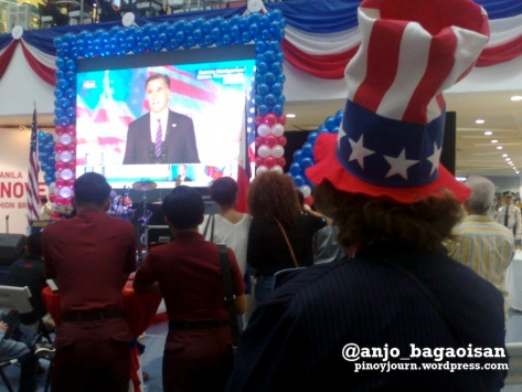 An American expat watches Republican candidate Mitt Romney concede at the US Embassy election watch event in Quezon City. (Shot by Anjo Bagaoisan)