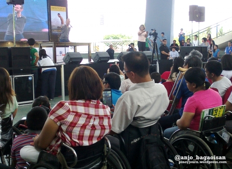 Filipino Persons With Disabilities (PWDs) listen to preacher Nick Vujicic at the SM Mall of Asia (Shot by Anjo Bagaoisan, May 20, 2013)