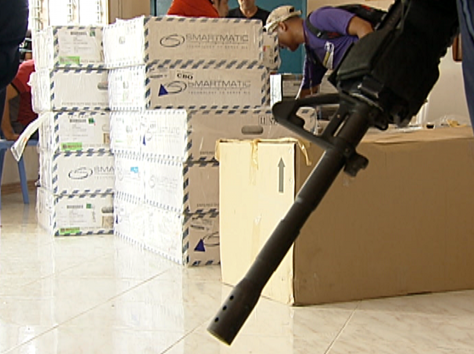 PCOS machines being guarded in Datu Saudi town, Maguindanao, May 2013 (Shot by Gani Taoatao, ABS-CBN News)
