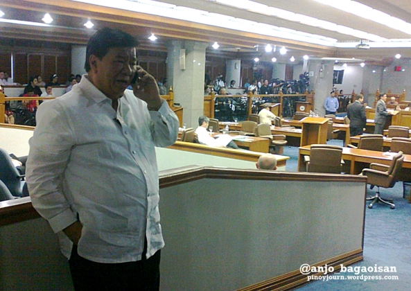 Sen. Franklin Drilon making a phone call at the Senate floor after Sen. Juan Ponce Enrile walks out folllowing his resignation as Senate President (Shot June 5, 2013 by Anjo Bagaoisan)