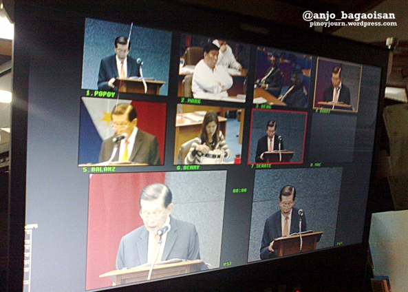ABS-CBN video monitor showing scenes at the Senate during Sen. Juan Ponce Enrile's speech resigning the Senate Presidency. (Shot June 5, 2013 by Anjo Bagaoisan)