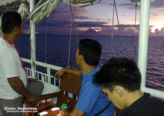 ABS-CBN News crew looking at the silhouette of Mayon Volcano from the sea during sunrise (Shot on June 15, 2013 by Anjo Bagaoisan)