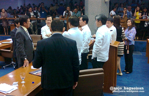 Philippine Senators discuss during a session suspension after Sen. Juan Ponce Enrile resigns the Senate Presidency and walks out. (Shot June 5, 2013 by Anjo Bagaoisan)