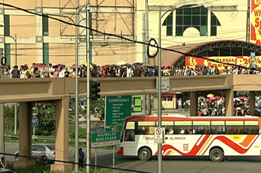Commuters climb the overpass from Coastal Mall to Roxas Boulevard looking for connecting trips to Manila. (Shot by Nestor Prillo, ABS-CBN News)