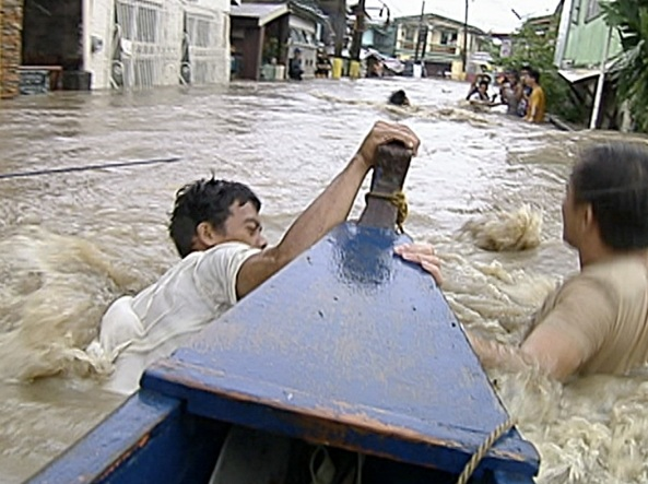 Kawit, Cavite - Chest deep floods passable by boat (Shot by William Natividad, ABS-CBN News)