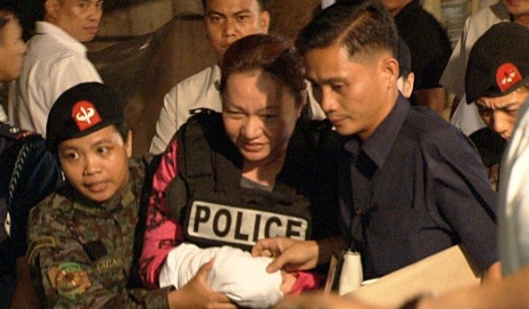 Pork Barrel scam suspect Janet Lim-Napoles being brought to the Makati City Jail. Ambush interview with DILG Sec. Mar Roxas and PNP Chief Alan Purisima outside the Makati City Jail on August 29, 2013 (Shot by Archie Torres, ABS-CBN News)
