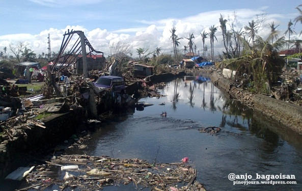 Debris, ruined property and trash at a river in Tacloban City after Typhoon Haiyan / Yolanda (Shot Nov. 27, 2013 by Anjo Bagaoisan)