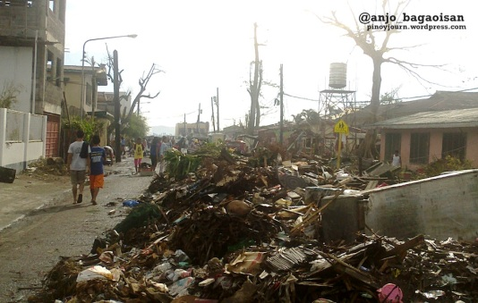 Piles of trash at a street in Tacloban City still uncollected 3 weeks after Typhoon Haiyan / Yolanda (Shot Nov. 26, 2013 by Anjo Bagaoisan)