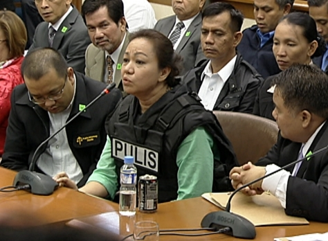 Janet Napoles surrounded by lawyers from the Public Attorney's Office (Shot Nov 7, 2013 by Angel Valderrama, ABS-CBN News)