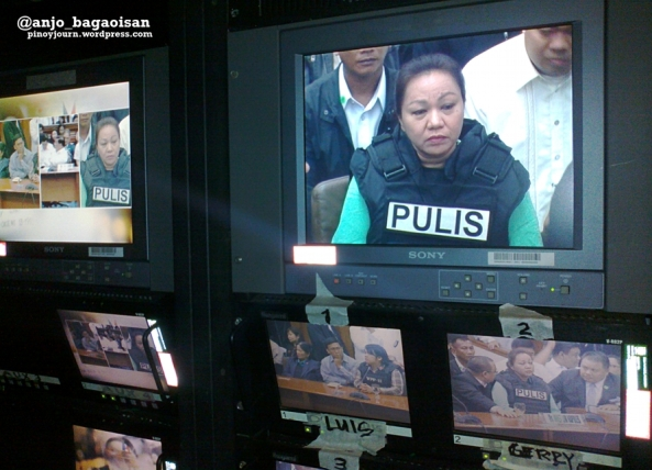 Monitors on ABS-CBN OB van show Janet Lim Napoles (Shot Nov 7, 2013 by Anjo Bagaoisan)