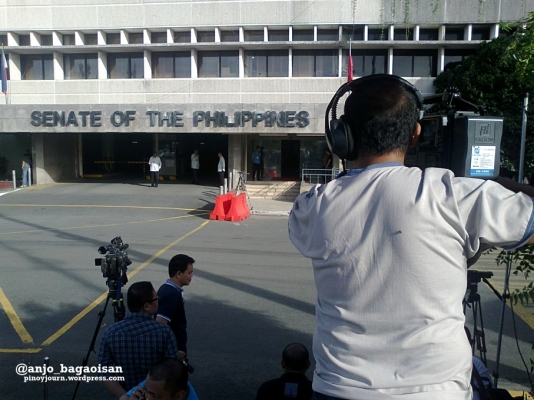 ABS-CBN cameraman shooting the facade of the Philippine Senate on the wait for Janet Lim Napoles (Shot Nov 7, 2013 by Anjo Bagaoisan)