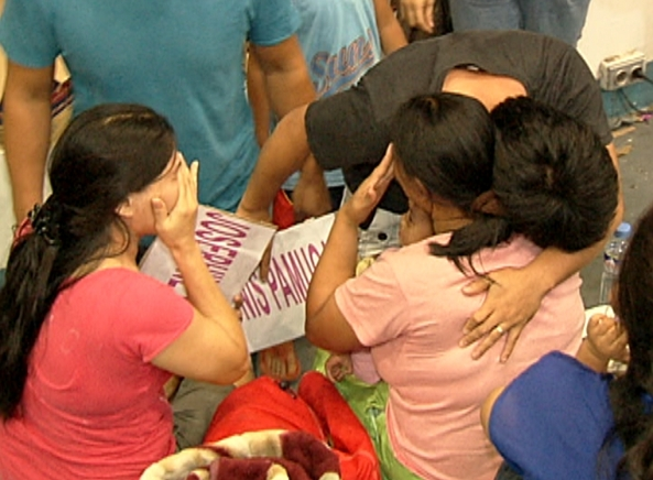 Family from Manila reunites with relatives from Tacloban at the Villamor Airbase (Shot by Nestor Conato, ABS-CBN News)