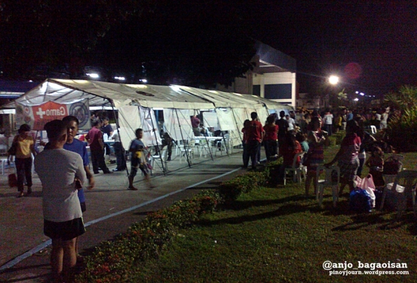 Military tent put up near Villamor Airbase to house services for Typhoon Yolanda survivors (Shot by Anjo Bagaoisan)
