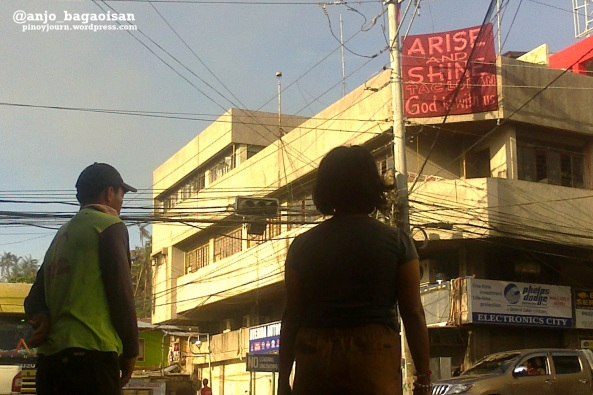 "Banner in Tacloban City says ""Arise and Shine Tacloban -- God is with us."" (Shot by Anjo Bagaoisan)"