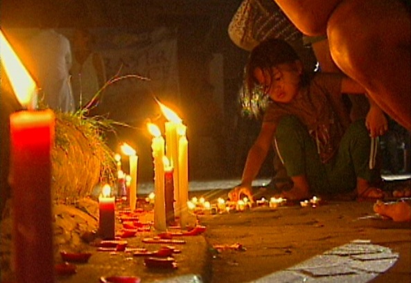 Candle lighting at Sto Niño Church (Shot by Ramel Gaddi, ABS-CBN News)