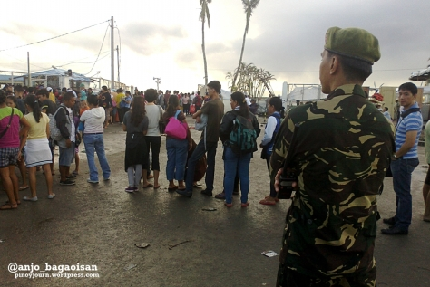 Line of survivors waiting for free ride on C-130 planes at the Tacloban City Airport, as the DSWD already prohibited such hitches. (Shots by Anjo Bagaoisan)