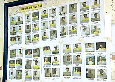 BJMP escapees: A poster detailing escaped prisoners highlights a concern in post-Yolanda Tacloban. (Shot by Brian Pimentel, ABS-CBN News)