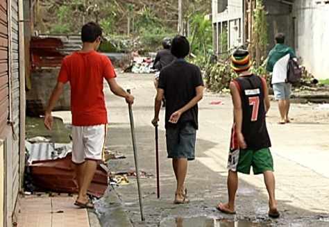 Community patrollers: The volunteers carry steel tubes for self-defense. (Shot by Archie Torres, ABS-CBN News)